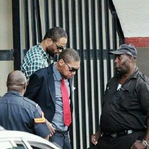 VYBZ KARTEL AND SHAWN STORM EXITING THE COURT